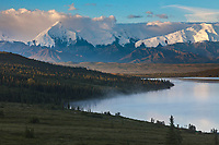 Early morning sunrise on the face of Denali,  and Wonder Lake, at the west end of Denali National Park, Interior, Alaska.