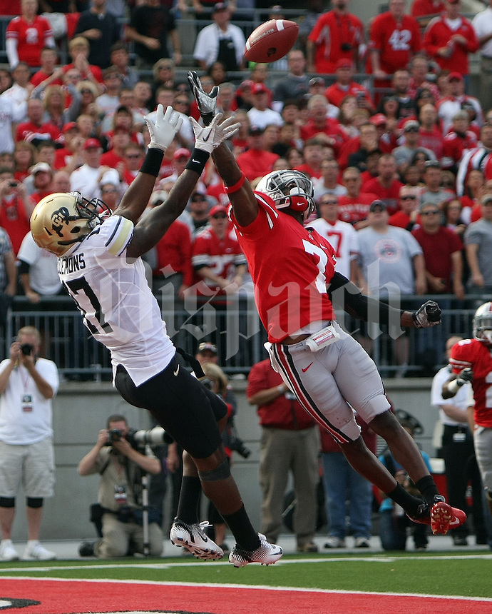 Colorado Buffaloes wide receiver Toney Clemons (17) makes a touchdown reception over the outstretched hand of Ohio State Buckeyes defensive back Travis Howard (7) in the second quarter of their NCAA football game at the Ohio Stadium in Columbus, September 25, 2011.  (Dispatch photo by Neal C. Lauron)