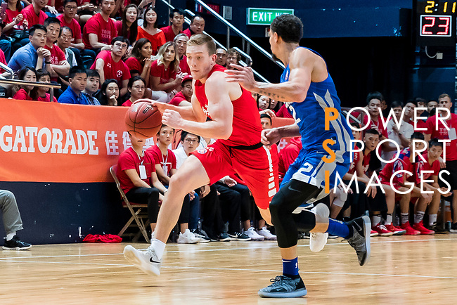 Dominic Robert Gilbert #11 of SCAA Men's Basketball Team dribbles the ball up court against the Eastern Long Lions during the Hong Kong Basketball League playoff game between SCAA and Eastern Long Lions at Queen Elizabeth Stadium on July 27, 2018 in Hong Kong. Photo by Yu Chun Christopher Wong / Power Sport Images