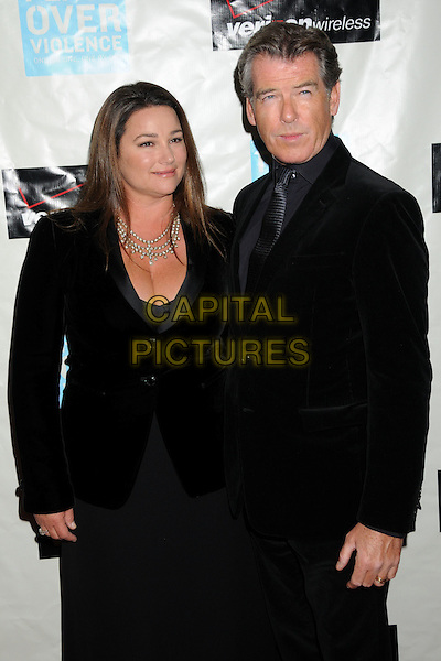 KEELY SHAYE SMITH & PIERCE BROSNAN .Attending the 38th Annual Peace Over Violence Humanitarian Awards held at The Beverly Hills Hotel, Beverly Hills, California, USA, 6th November 2009..half length married couple black velvet jacket cleavage keeley husband wife.CAP/ADM/BP.©Byron Purvis/AdMedia/Capital Pictures.