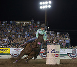 Kelsey Lutjen from Casa Grande, AZ competes in the Barrel Racing event during Wolf Pack Night at the Reno Rodeo on Wednesday, June 22, 2016.