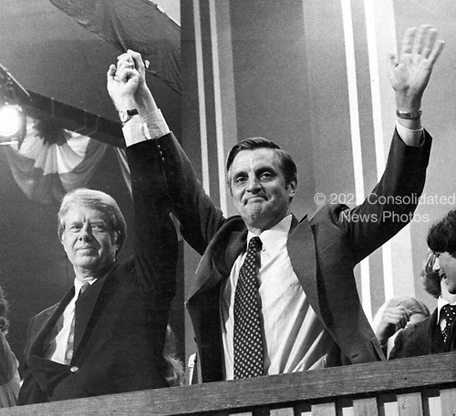 Governor Jimmy Carter (Democrat of Georgia), the 1976 Democratic Party nominee for President of the United States, left, and US Senator Walter Mondale (Democrat of Minnesota), the 1976 Democratic Party nominee for Vice President of the US, right, acknowledge the cheers of the delegates following their acceptance speeches at the 1976 Democratic Convention  at Madison Square Garden, New York, New York on July 15, 1976.<br /> Credit: Frank Jurkoski / CNP