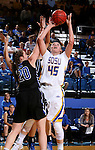 BROOKINGS, SD - NOVEMBER 3:  Ellie Thompson #45 from South Dakota State shoots over Ashley Bray #20 from Dakota Wesleyan in the first half of their exhibition game Thursday night at Frost Arena. (Photo by Dave Eggen/Inertia)