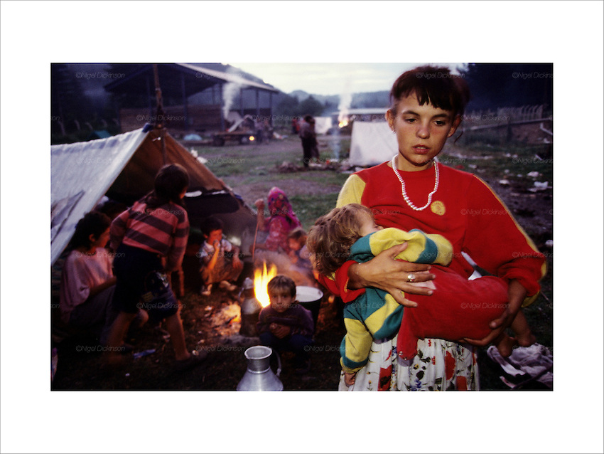 Fleeing Kosovo over the border, families camp on the high ground, they will go to Konik before winter. Roma were accused of accomplice with the Serbs. Hundreds of thousands of Roma were ethnically cleansed from Kosovo after the war. Birazne, Montenegro Summer 1999...Roma Gypsies left Rajasthan in India a thousand years ago, in the ninth and tenth centuries. They were pushed west by the Ottoman Muslim Empire as it moved through Persia towards the frontiers of Europe. They entered Europe in the foutrteenth century and were slaves in Romania and Moldavia until the mid 1850s. There are about 15 million Roma gypries in the world, about 12 million who live in Europe. they are Europe's largest ethnic minority. They have rich traditions and culture, their own language. They are renowned for their prowess in music and dance; they are also skilled craftsman, metal roofmakers, silver and goldsmiths. Their traveling and nomadic lifestyle which grew from a necessity to find work, and because they were often moved on from one place to the next, has given them both a liberty but also marks them as different and they are often feared by sedentary peoples, who label and scapegoat them. They are hardy survivors and live in the brunt of racism and prejudice, often marginalised, living in poverty, without proper human rights afforded to them..