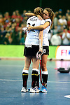 Leipzig, Germany, February 08: Franzisca Hauke #21 of Germany is hugged by Anne Schroeder #8 of Germany after missing the final shoot-out during the women gold medal match between Germany (white) and The Netherlands (orange) on February 8, 2015 at the FIH Indoor Hockey World Cup at Arena Leipzig in Leipzig, Germany. Final score 1-2 after shoot out. (Photo by Dirk Markgraf / www.265-images.com) *** Local caption ***