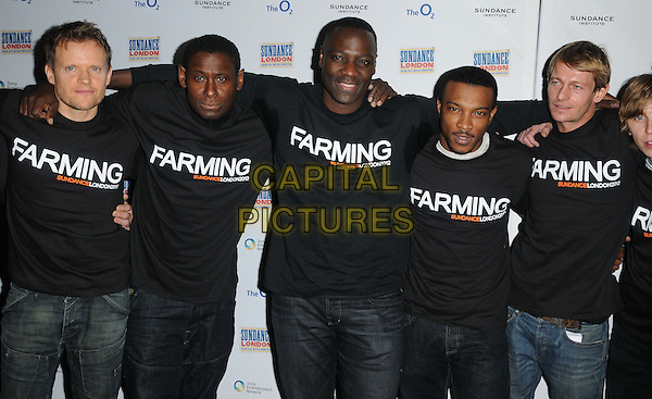 Marc Warren, David Harewood, Adewale Akinnuoye-Agbaje, Ashley Walters & Leo Gregory.The 'Farming' table read & photocall, Sundance London film & music festival day 2, O2 Cineworld cinema, The O2 Arena, Greenwich, London, England..April 27th, 2012.half length black t-shirt jeans denim arms over shoulders sweat sweating patches armpits.CAP/CAN.©Can Nguyen/Capital Pictures.