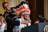 Washington, DC - August 12, 2009 -- United States President Barack Obama (L) smiles as he attempts to avoid hitting the headdress of Joe Medicine Crow, as he presents him the 2009 Medal of Freedom, America's highest civilian award.  The award is the highest honor a civilian can achieve for being recognized for their outstanding achievements in life. The award were given to Stephen Hawking, Ted Kennedy, Billie Jean King, Harvey Milk (posthumously) , Sandra Day O'Connor, Desmond Tutu, Dr. Pedro Jose Greer, Nancy Goodman Brinker, Jack Kemp (posthumously), Reverend Joseph Lowery, Dr. Joseph Medicine Crow, Mary Robinson, Janet Davison Rowley, Dr. Muhammad Yunus, Chita Rivera, and Sidney Poitier. .Credit: Gary Fabiano / Pool via CNP