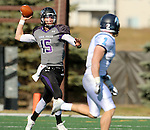 SIOUX FALLS, SD - NOVEMBER 8: Luke Papilion #15 from the University of Sioux Falls looks for a receiver past Jeff Arends #2 from Upper Iowa in the first quarter of their game Saturday afternoon at Bob Young Field in Sioux Falls.  (Photo by Dave Eggen/Inertia)