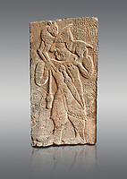 Pictures & images of the North Gate Hittite sculpture stele depicting Hittite man with a sheep on his shoulders. 8th century BC. Karatepe Aslantas Open-Air Museum (Karatepe-Aslantaş Açık Hava Müzesi), Osmaniye Province, Turkey. Against grey background