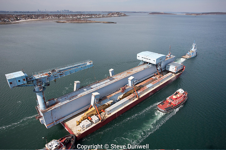 "Tugboat ""Allie B"" and barge ""Harvey"", taking Goliath Crane, from Quincy, MA  aerial"