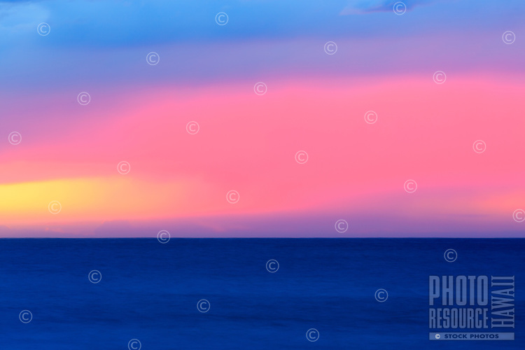 A detail of the clouds, horizon and ocean reveals a stunning sunset in pink and blue at Ke'e Beach, Na Pali Coast, Kaua'i.
