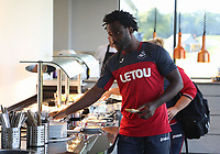 Pictured: Wilfried Bony takes food from the restaurant counter at the Fairwood Training Ground, Wales, UK. Thursday 31 August 2017<br />