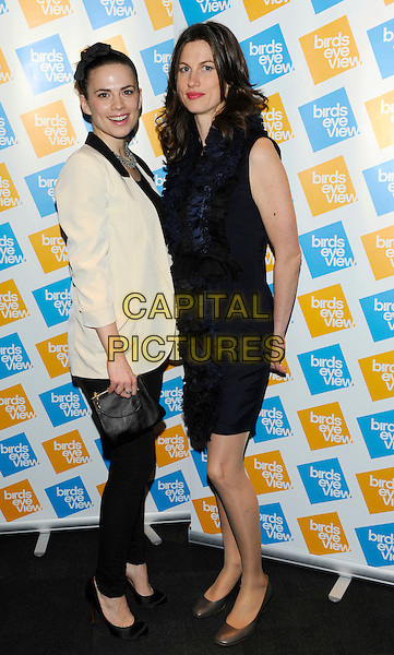 "HAYLEY ATWELL & LUCY WALKER.Attends the ""Birds Eye View Film Festival"", Closing Night Photocall, BFI Southbank, London, England..March 17th, 2011.full length black white leggings top jacket blazer clutch bag sleeveless dress side navy blue frills ruffle.CAP/CJ.©Chris Joseph/Capital Pictures."