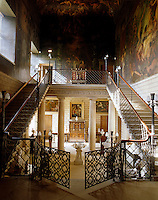 The Hall Staircase features a gated cantilevered staircase. The ceiling was painted by Antonio Verrio in the 18th century and the walls were by Thomas Stothard in the 19th century
