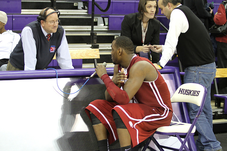 Bud Nameck, the radio voice of Washington State Cougar basketball, interviews DeAngelo Casto after the Cougars 80-69 road victory over arch-rival Washington at the Alaska Airlines Arena in Seattle, Washington, on February 27, 2011.  With the victory, Casto and the Cougars swept the regular season series from the Huskies, two games to none.