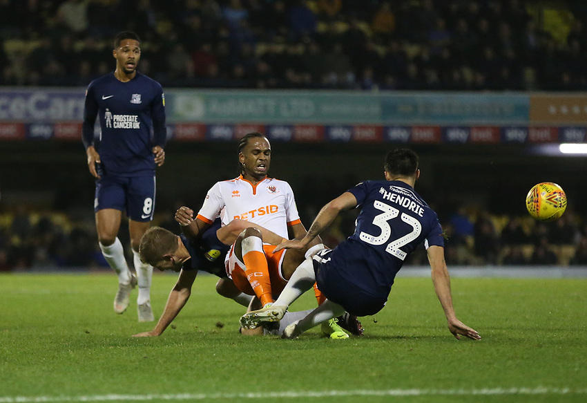 Blackpool's Nathan Delfouneso is challenged by Southend United's Stephen Hendrie<br /> <br /> Photographer Rob Newell/CameraSport<br /> <br /> The EFL Sky Bet League One - Southend United v Blackpool - Saturday 17th November 2018 - Roots Hall - Southend<br /> <br /> World Copyright © 2018 CameraSport. All rights reserved. 43 Linden Ave. Countesthorpe. Leicester. England. LE8 5PG - Tel: +44 (0) 116 277 4147 - admin@camerasport.com - www.camerasport.com