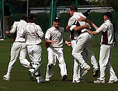 Dundermline CC V Arbroath CC, Scottish National Cricket League, Div One, at McKane Park, Dunfermline - with bowler Fraser Burnett held high, Arbroath celebrate a wicket - Picture by Donald MacLeod 01.08.09 (details in file info)