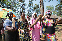 Africa, DRC, Democratic Republic of the Congo, South Kivu, Kamanyola. Women for Women project. WFW Kamanyola co-op and lifeskills training. Women dancing in greeting. Women with their cassava.