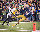Nov. 14, 2015; Corey Robinson (88) attempts to catch a pass as Wake Forest cornerback Dionte Austin (11) defends in the fourth quarter at Notre Dame Stadium. Austin was flagged for pass interference on the play. Notre Dame won 28-7. (Photo by Matt Cashore)