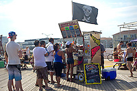 Santa Salsa concession cart selling South American inspired food on the boardwalk at Rockaway Beach in the Queens borough of New York on Saturday, June 30, 2012 during the long Fourth of July weekend.  (© Frances M. Roberts)