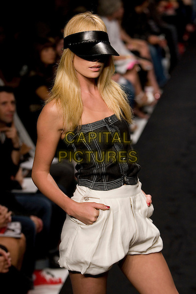 MODEL.Mercedes-Benz Spring 2007 L.A. Fashion Week - Evisu - Runway held at Smashbox Studios, Culver City, California, USA..October 15th, 2006.Ref: ADM/ZL.half length modelling catwalk white shorts black strapless top visor.www.capitalpictures.com.sales@capitalpictures.com.©Zach Lipp/AdMedia/Capital Pictures.