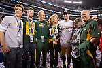 Green Bay Packers quarterback Aaron Rodgers (wearing hat) poses for a photo with his family after winning Super Bowl XLV against the Pittsburgh Steelers on Sunday, February 6, 2011, in Arlington, Texas. The Packers won 31-25. (AP Photo/David Stluka)