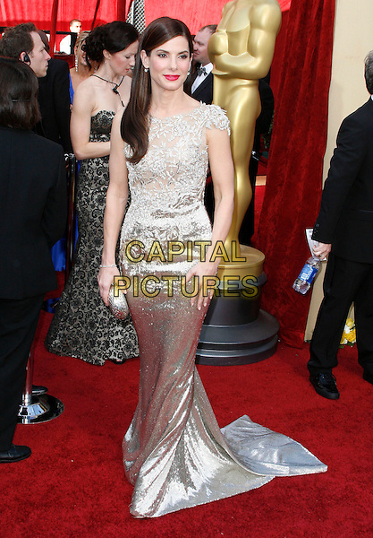 SANDRA BULLOCK.The 82nd Annual Academy Awards held aat The Kodak Theatre in Hollywood, California, USA..March 7th, 2010.oscars  full length dress silver clutch bag gold beige beads beaded  maxi train .CAP/EAST.©Eastman/Capital Pictures.