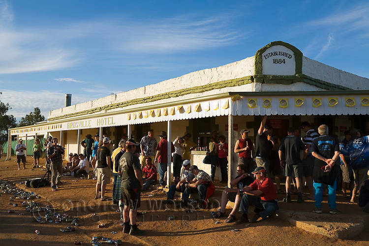 Drinkers at the historic Birdsville Hotel during the annual Birdsville races.  Every September the small town hosts the most famous horse racing carnival in outback Australia.  Birdsville, Queensland, AUSTRALIA.  © Andrew Watson / Axiom