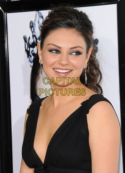 "MILA KUNIS.The AFI Fest 2010 Closing Night Gala - ""Black Swan"" Premiere held at The Grauman's Chinese Theatre in Hollywood, California, USA .November 11th, 2010       .headshot portrait black sleeveless dangling silver earrings eyeliner smokey eyes make-up beauty  .CAP/RKE/DVS.©DVS/RockinExposures/Capital Pictures."
