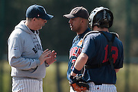 11 April 2010: Team manager Francois Colombier of Rouen talks to Keino Perez during game 1/week 1 of the French Elite season won 5-1 by Rouen over Montigny, at the Cougars Stadium in Montigny le Bretonneux, France.