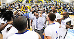The Gazette Head Coach of Friendly High School Rob Garner, center, does a celebration dance as his team surrounds him after their 77-60 victory over Henry E. Lackey High School  for the 3A Maryland Public Secondary Schools Athletic Association Regional Championship on Saturday afternoon held at Dr. Henry a. Wise Jr. High School in Upper Marlboro. On the right of the coach are players Bryan Brooks, center, and Montez Bentley.