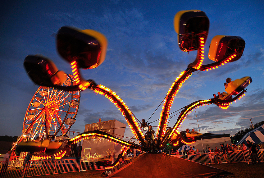 Ferris wheel and Spider ride at dusk.  Oktoberfest opens at Redstone Arsenal Parade Field.  Bob Gathany photo
