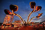 Ferris wheel and Spider ride at dusk.  Oktoberfest opens at Redstone Arsenal Parade Field.  Bob Gathany photo