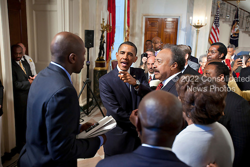 United States President Barack Obama shouts an order to his personal aide, Reggie Love (L), while shaking hands after delivering remarks at the Historically Blacks Colleges and Universities reception in the Grand Foyer of the White House in Washington, DC on Monday,13 September, 2010..Credit: Jim Lo Scalzo - Pool via CNP