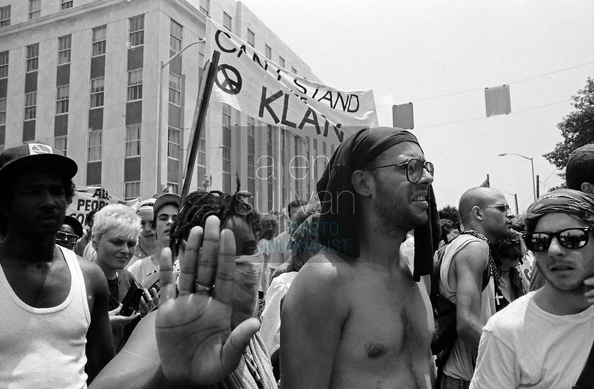 Anti-Ku Klux Klan protesters march during the 1988 Democratic National Convention in downtown Atlanta, Georgia.
