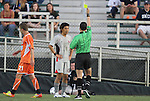 14 April 2012: Atlanta's Kohei Matsushita (JPN) (15) is showed the yellow card by referee Jose Carlos Rivero (in green). The Carolina RailHawks played the Atlanta Silverbacks to a 4-4 tie at WakeMed Soccer Stadium in Cary, NC in a 2012 North American Soccer League (NASL) regular season game.