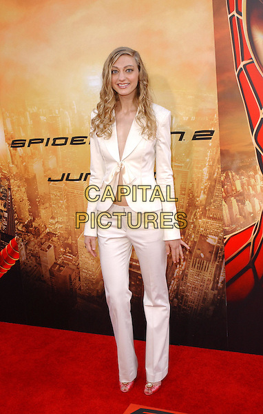 MAGEINA TOVAH.Columbia Pictures' World Premiere of Spider-Man 2 held at The Mann Village Theatre in Westwood, .California, .June 22nd 2004..full length full-length suit nothing underneath midriff bare belly tummy skinny spiderman.Copyright 2004 by Debbie VanStory.*UK sales only*.www.capitalpictures.com.sales@capitalpictures.com.©Capital Pictures