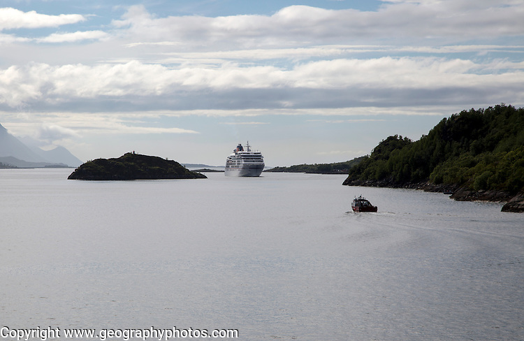 Hurtigruten ferry ship in water of Raftsundet strait of Hinnoya Island, Nordland, northern Norway