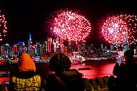 People watch the fireworks while The Empire State Building is lit in red and gold in honor to the Chinese New Year in New York, 02/06/2016. Photo by VIEWpress