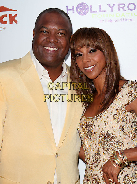 RODNEY PEETE & HOLLY ROBINSON PEETE .12th Annual HollyRod DesignCare Event held at The Ron Burkleís Green Acres Estate, Beverly Hills, CA, USA,  .24th July 2010..half  length yellow beige suit beaded dress husband wife couple .CAP/ADM/KB.©Kevan Brooks/AdMedia/Capital Pictures.
