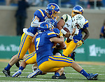 BROOKINGS, SD - SEPTEMBER 17:  A trio of defenders including Jesse Bobbit #7 and Chris Balster #28 from South Dakota State University wraps up Dano Graves #7 from Cal Poly in the first half of their game Saturday night at the Dana J. Dykhouse Stadium in Brookings. (Photo by Dave Eggen/Inertia)