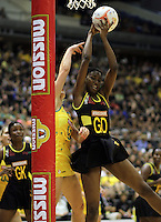 09.07.2011 Jamaica's Malysha Kelly in action during the netball match between Jamaica and Australia at the Mission Foods World Netball Championship 2011 held at the Singapore Indoor Stadium in Singapore . Mandatory Photo Credit ©Michael Bradley.