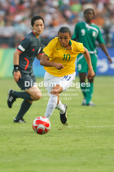 BEIJING, CHINA - AUGUST 12:  Marta of Brazil (10) drives the ball during a Beijing Olympic Games women's soccer tournament match against Nigeria August 12, 2008 at Workers' Stadium in Beijing, China.  Editorial use only.  (Photograph by Jonathan Larsen)