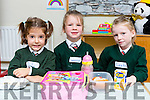 Paula Amunategiu, Saoirse Teahan and Leah Cooper tucking into their lunch at Firies NS junior infants on their first day at school on Wednesday