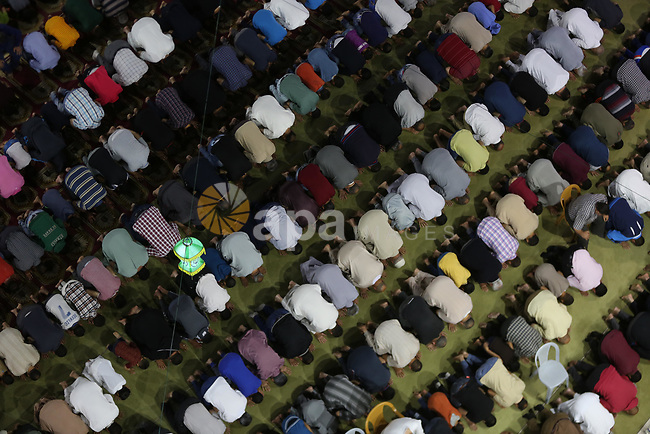 "Palestinian Muslim worshipers perform ""Taraweeh"", nightly prayer of the month of Ramadan, at Sayed Hashim mosque, in Gaza city, on May 26, 2017. Photo by Mohammed Asad"