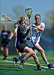 28 April 2012: University of Vermont Catamount midfielder Adison Rounds, a Senior from Centennial, CO, defends against University at Albany Great Dame midfielder/defender Mel Rorie, a Senior from Lansdale, PA, at Virtue Field in Burlington, Vermont. The Lady Danes defeated the Lady Cats 12-10 in America East Women's Lacrosse. Mandatory Credit: Ed Wolfstein Photo