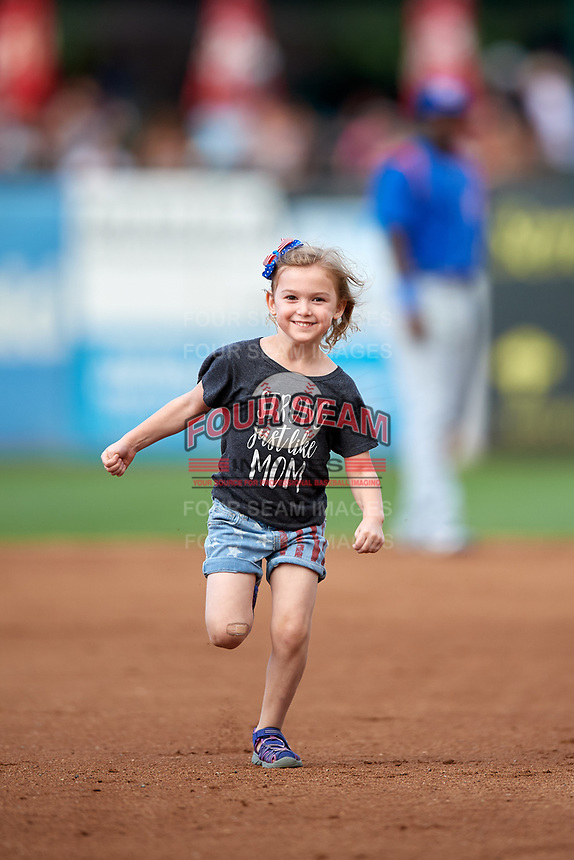 A young fan runs the bases during a Kane County Cougars game against the South Bend Cubs on July 21, 2018 at Northwestern Medicine Field in Geneva, Illinois.  South Bend defeated Kane County 4-2.  (Mike Janes/Four Seam Images)