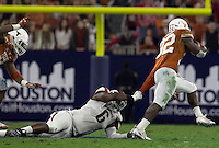 Arkansas Democrat-Gazette/BENJAMIN KRAIN --12/29/14--<br /> Arkansas defender JaMichael Winston grabs the jersey of Texas running back Johnathan Gray during the 2nd quarter in the Texas Bowl Monday night at NRG Stadium in Houston.