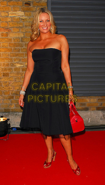 SARAH BOSNICH.OK! Magazine - private 10th anniversary party, Old Billingsgate, London, UK..May 10th, 2006.Ref: CAN.full length black strapless dress red purse bag shoes.www.capitalpictures.com.sales@capitalpictures.com.©Capital Pictures