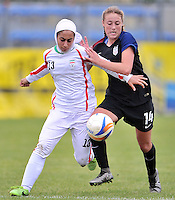 Monfalcone, Italy, April 26, 2016.<br /> Iran's #13 Noorizadeh (L) fights for the ball with USA's #14 Wingate (R) USA v Iran football match at Gradisca Tournament of Nations (women's tournament). Monfalcone's stadium.<br /> &copy; ph Simone Ferraro / Isiphotos